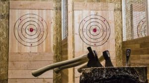 Axes in front of axe throwing target