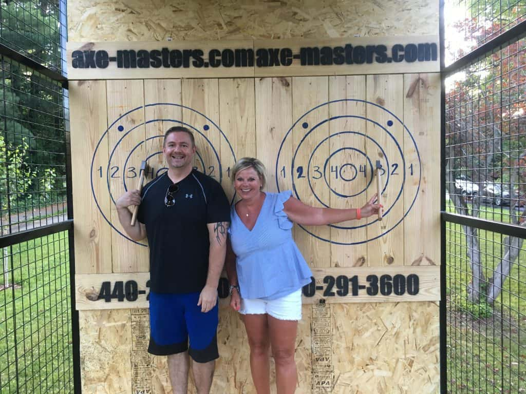 couple in mobile axe throwing trailer